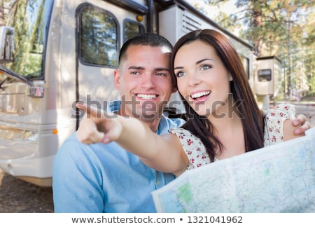 Young Military Couple Looking at Map In Front of RV Stock photo © feverpitch