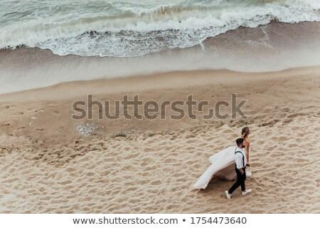 çift · eller · genç · mutlu · el · ele · tutuşarak - stok fotoğraf © elenabatkova