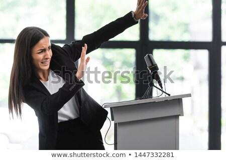 Femme d'affaires podium parler conférence fenêtres composite numérique Photo stock © wavebreak_media