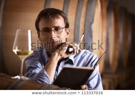 Elégedett néz üveg fehérbor pince mosolyog Stock fotó © lichtmeister