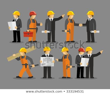 Travailleur de la construction architecte lecture plan travaux Photo stock © Kzenon