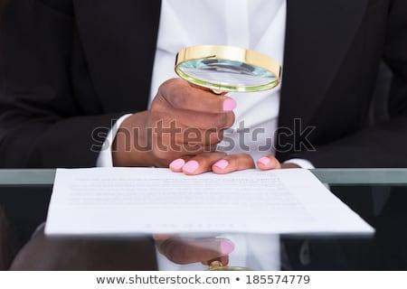 Auditor fraude lupa negócio escritório mulher Foto stock © AndreyPopov