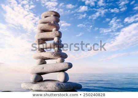 Small pyramid from stones on seacoast Stock photo © Paha_L