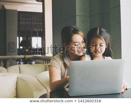 young mother teaching her daughter how to use computer stock photo © photography33