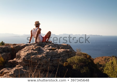 Young man with  straw hat watching at the distance stock photo © elly_l