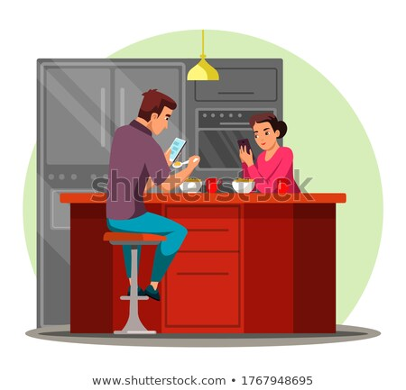Couple eating breakfast separately Stock photo © photography33