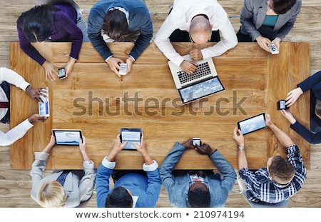 Stock photo: multi-ethnic team with mobile