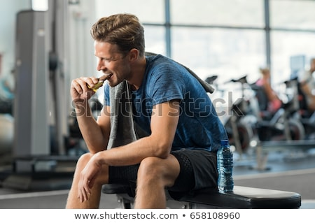 Man eating a bar of chocolate Stock photo © photography33
