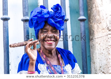 Old woman smoking a cigar Stock photo © sumners