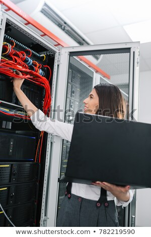 portrait of a woman fixing a computer Stock photo © photography33