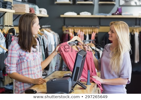 Woman at the till in the clothing store Stock photo © wavebreak_media