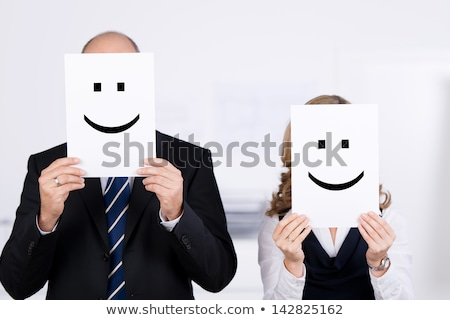 Mature woman showing smiley face Stock photo © bmonteny