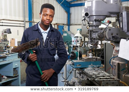 Apprentice In Engineering Factory Sweeping Floor Stock photo © HighwayStarz