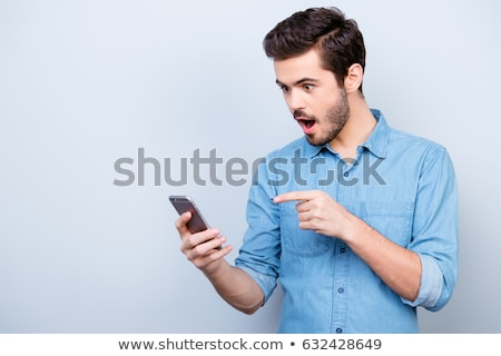 Jóvenes empresario sorprendido teléfono cara funny Foto stock © NicoletaIonescu