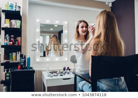 Beautician apply makeup to a model Stock photo © dash