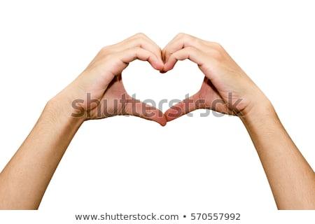 closeup of man hands with heart Stock photo © dolgachov