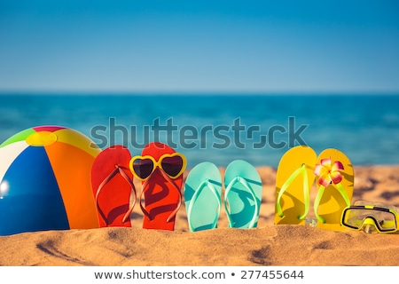 flip flops for family on the beach stock photo © adrenalina