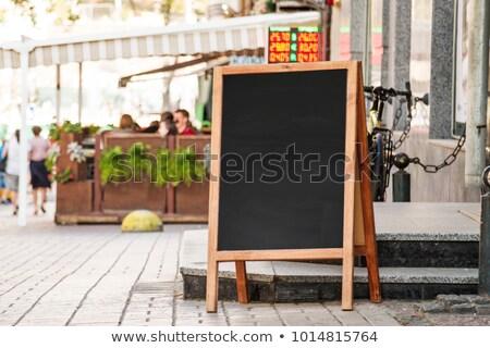Blank menu blackboard on cafe wall Stock photo © stevanovicigor