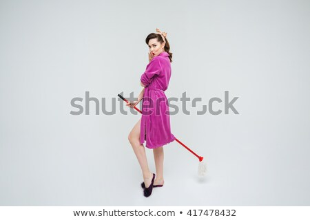 Cute playful pinup girl standing and sending a kiss Stock photo © deandrobot