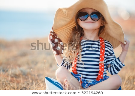 Stockfoto: Beautiful Little Girl In Summer Hat And Sunglasses