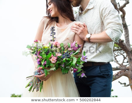 Couple in love, gorgeous bride and stylish groom on top, fine ar Stock photo © Yatsenko