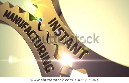 Instant Manufacturing Concept. Golden Metallic Gears. Stock photo © tashatuvango