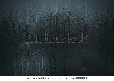 rain water drops flow down blue background stock photo © romvo