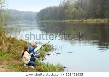 Grandfather and granddaughter fishing Stock photo © IS2