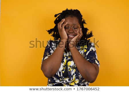 emotional confident plus size model standing in studio showing her sexuality on gray background stock photo © traimak