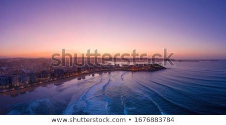 Gijon skyline sunset in San Lorenzo beach Asturias Stock photo © lunamarina