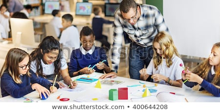 Girl Solving Math On Digital Tablet Stock photo © AndreyPopov