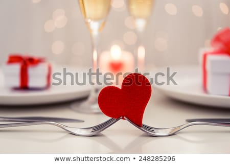 romantic dinner decoration red candles flower petals on the t stock photo © dash