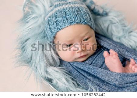 Neu geboren Baby Junge gestrickt Decke Gesicht Stock foto © galitskaya