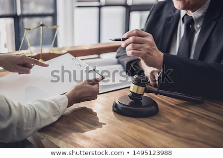 Judge gavel with scales of justice, male lawyers working having  Stock photo © Freedomz
