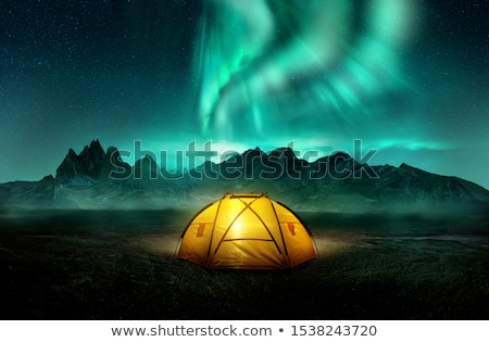 camping under dancing green aurora northern lights stock photo © solarseven