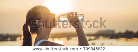 BANNER Sporty woman drinking water outdoor on sunny day Long Format Stock photo © galitskaya