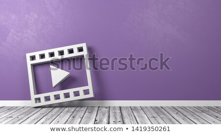 Film Movie Play Symbol on Wooden Floor Against Wall Stock photo © make