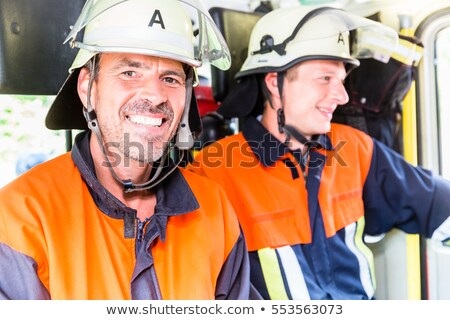 Women at the German voluntary fire department Stock photo © Kzenon