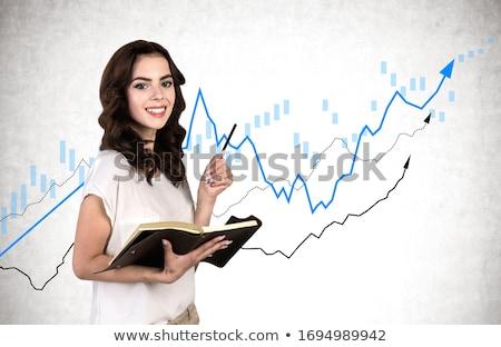 Woman Standing near Statistics Chart, Data Graph Stock photo © robuart