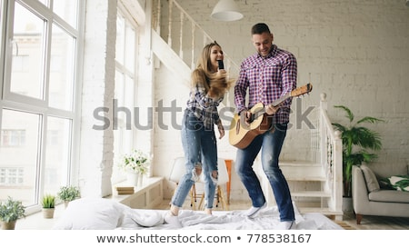 Young happiness man on bedroom in enjoying playing the music and Stock photo © Freedomz
