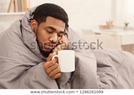 adam · enfekte · soğuk · yatak · genç · burun · üfleme - stok fotoğraf © leeser