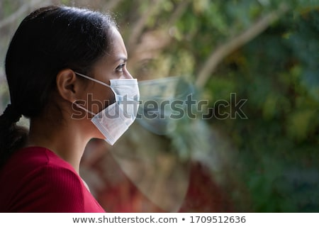 Worried looking young brunette. Stock photo © lithian