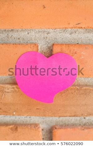 Czerwony serca starego papieru Stick murem miłości Zdjęcia stock © Archipoch