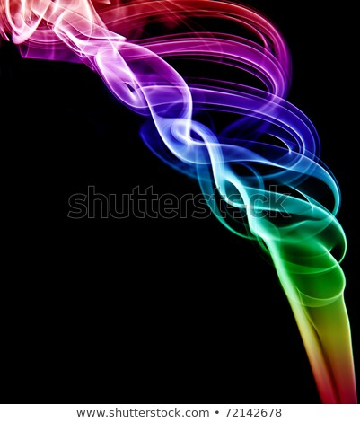 A swirled spiral of colored smoke on a black background Stock photo © ozaiachin