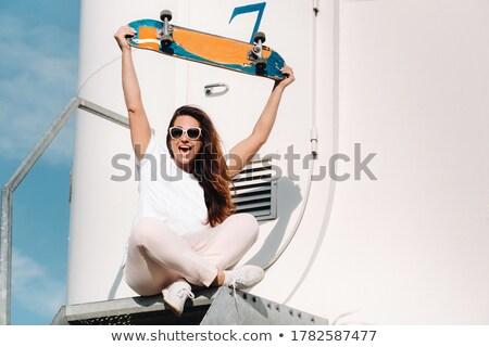 Fiatal nő ül szélturbinák égbolt szépség nyár Stock fotó © photography33