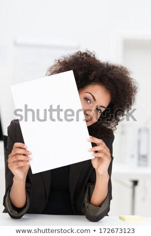 playful woman holding white empty board stock photo © acidgrey