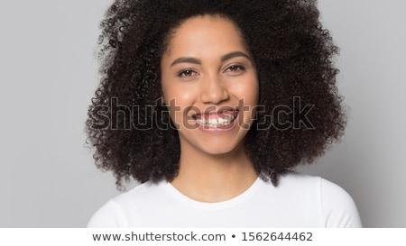 primer · plano · sonriendo · femenino · paciente · mirando · cámara - foto stock © wavebreak_media