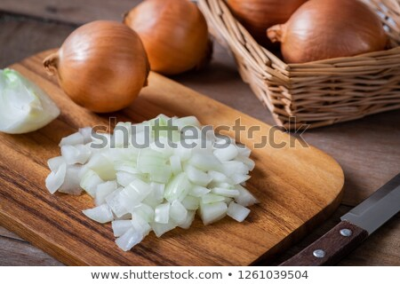 onion  with knife on wooden table Stock photo © neirfy