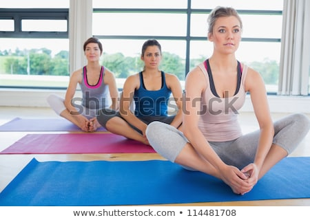 Woman sitting in bound angle yoga pose and smiling stock photo © wavebreak_media
