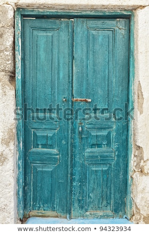 aged wooden color door in mediterranean stock photo © lunamarina